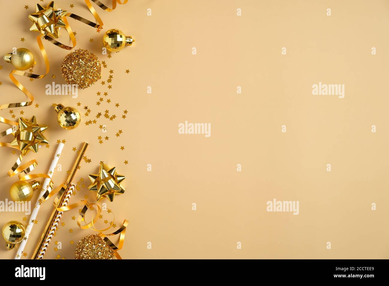 https www alamy com christmas party invitation card mockup flat lay golden christmas balls decorations tinsel confetti on yellow background top view with copy space image369331825 html