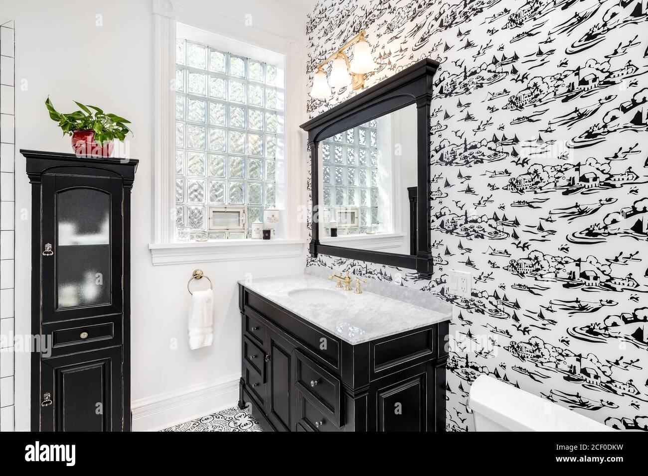 https www alamy com a renovated black and white bathroom with wallpaper black vanity decorative tiles on the floor and subway tiles in the shower image370648317 html
