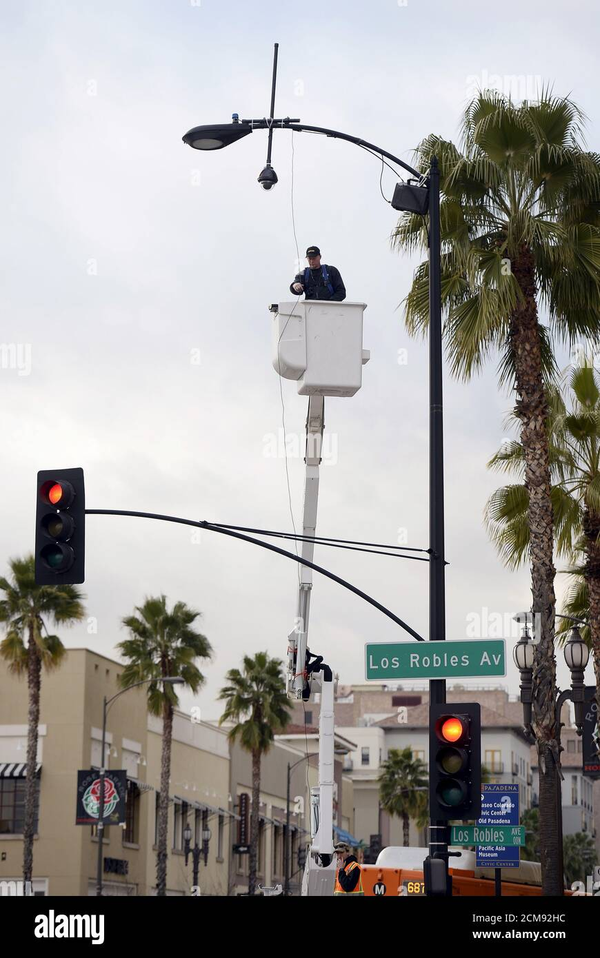 https www alamy com a worker puts up a surveillance camera on a street light pole along the route of the parade on colorado boulevard in preparation for the rose parade in pasadena california december 28 2015 reuterskevork djansezian image373910472 html