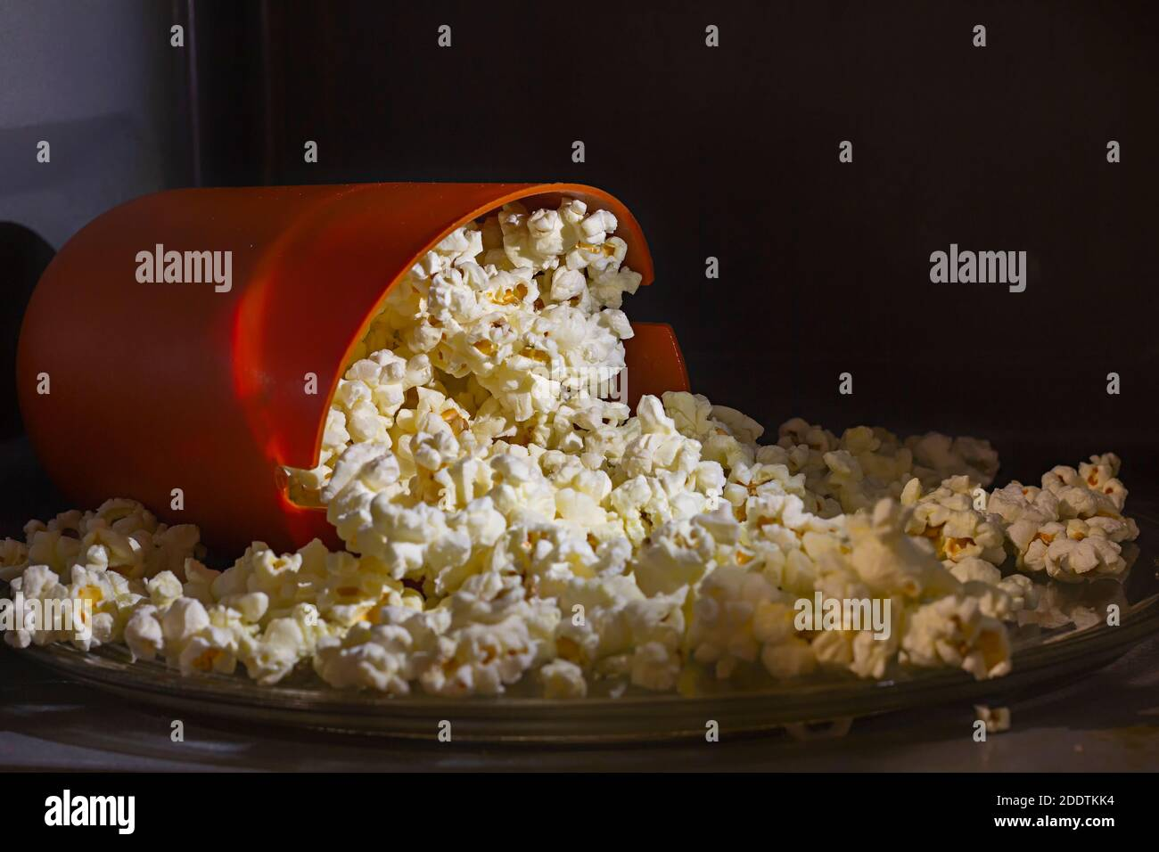 https www alamy com orange silicon bucket filled with homemade cooked popcorn inside a microwave oven special silicon bucket for popcorn microwave cooking at home image387160904 html