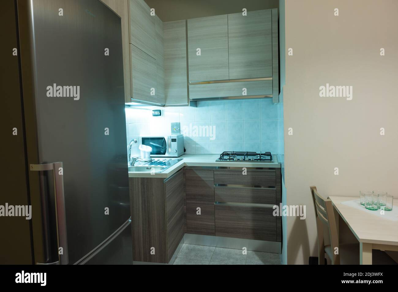 https www alamy com view of a modular corner kitchen in gray and brown color the led under cabinet light attracts attention image389777806 html