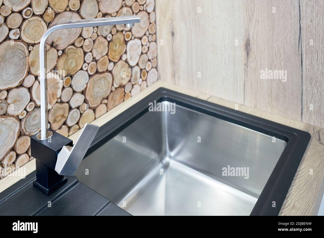 https www alamy com modern design chrome rectangular section water tap closeup over stainless steel sink on table top made of natural wooden kitchen apron decorated with image389944965 html