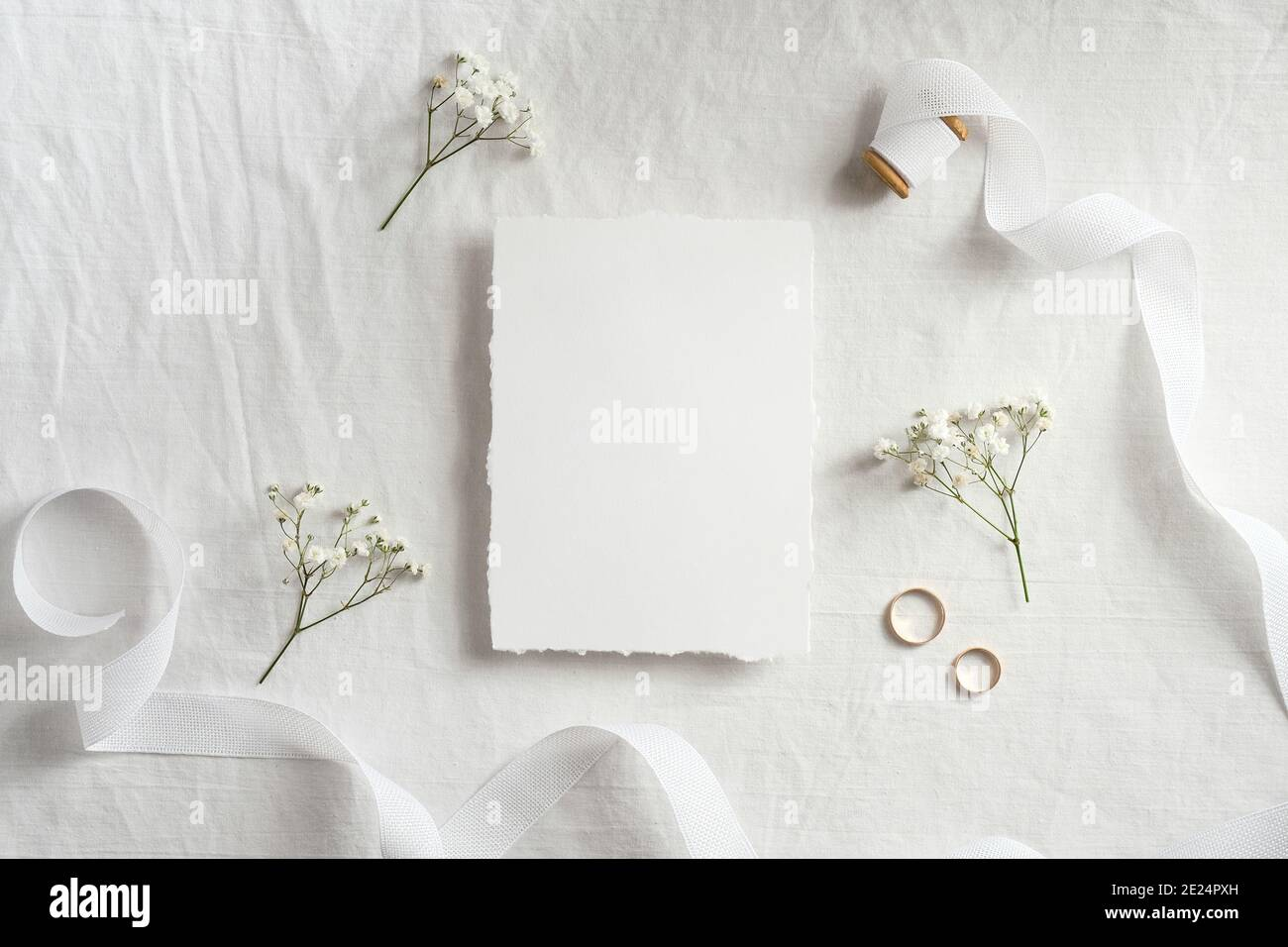 https www alamy com wedding invitation card template top view blank paper card ribbon golden rings flowers on white background image397173577 html