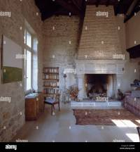 Large stone fireplace in country living room with stone ...