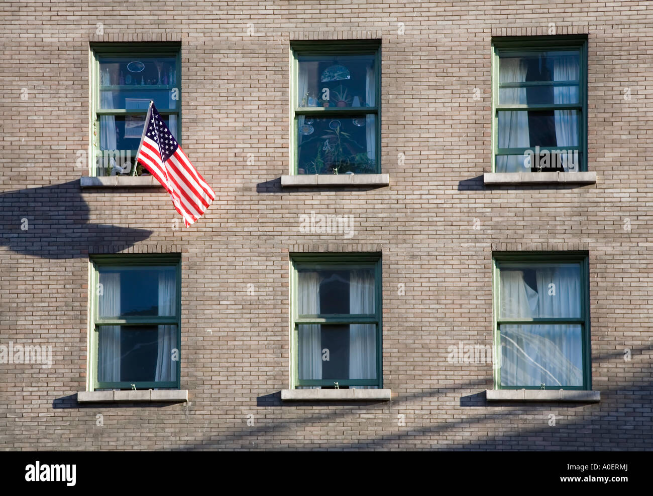 Apartment windows in building with American flag flying