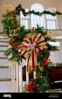 Christmas decorations on a staircase banister Stock Photo ...