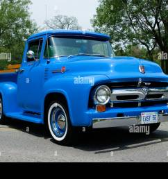 1956 ford f100 custom cab pickup truck on pavement stock image [ 1300 x 956 Pixel ]