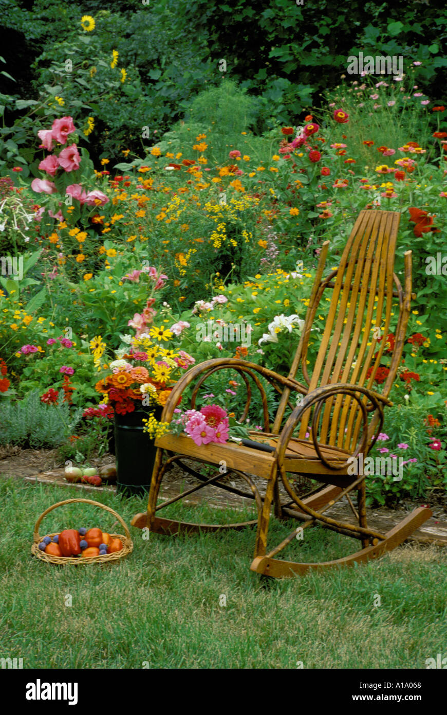 Bentwood Victorian rocking chair beside colorful annual