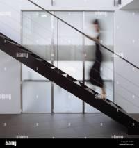Blurred figure walking up modern metal staircase Stock ...