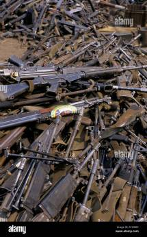 Zairean Army Collect Weapons Rwandan Soldiers