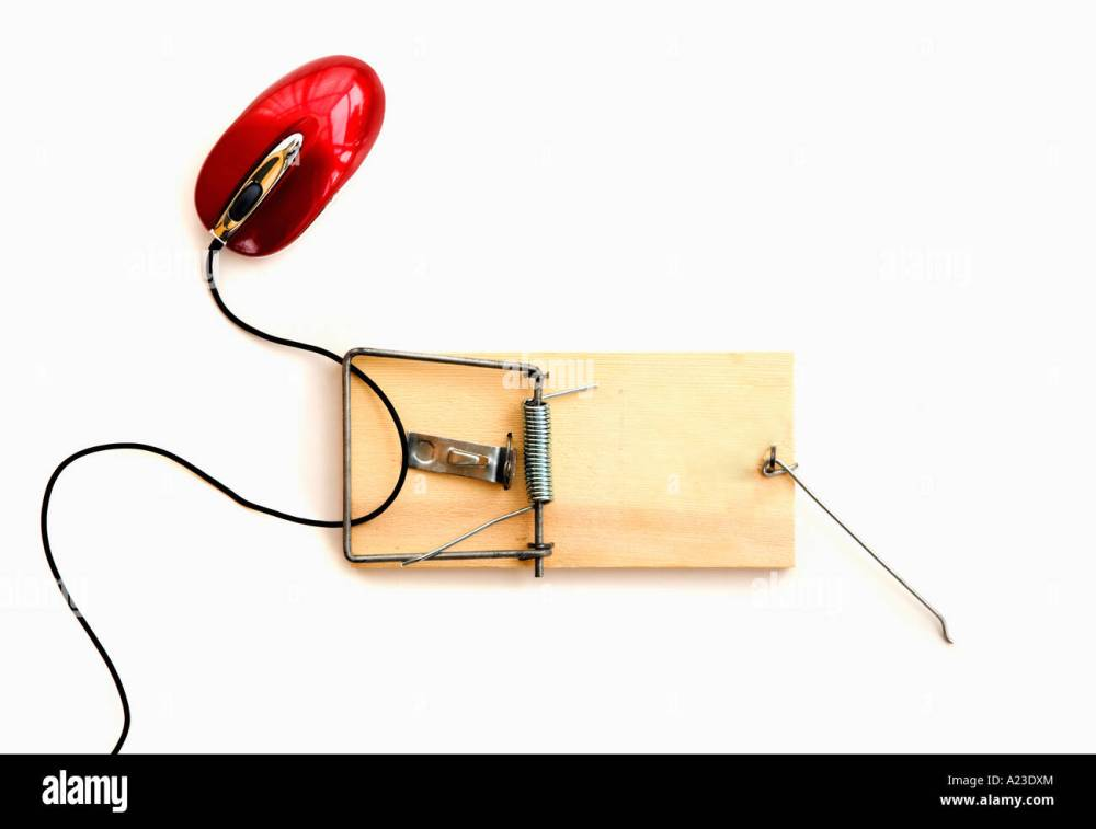 medium resolution of computer mouse caught in a wooden mousetrap