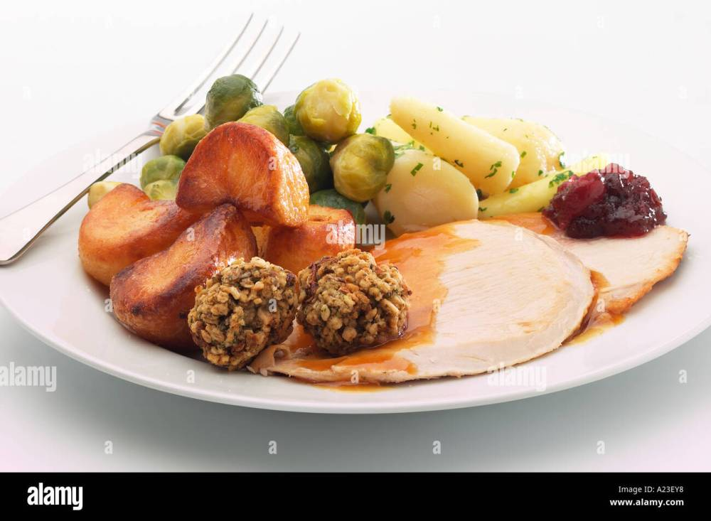 medium resolution of plate of christmas dinner with turkey stuffing roast potatoes sprouts gravy and cranberry sauce