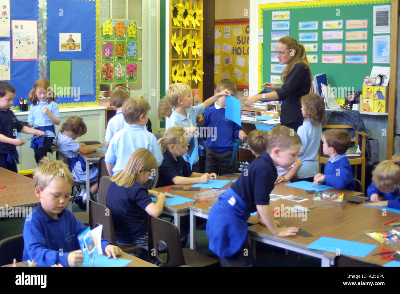 First Year 5 And 6 Year Old Students In Classroom With
