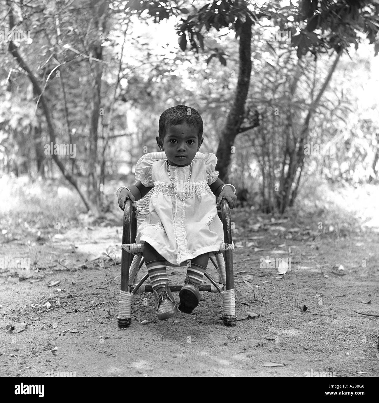 baby sitting chair india big round sofa vintage girl in stock photos and