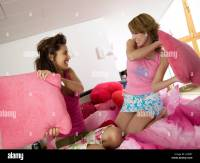 Two teenage girls having pillow fight Stock Photo, Royalty ...