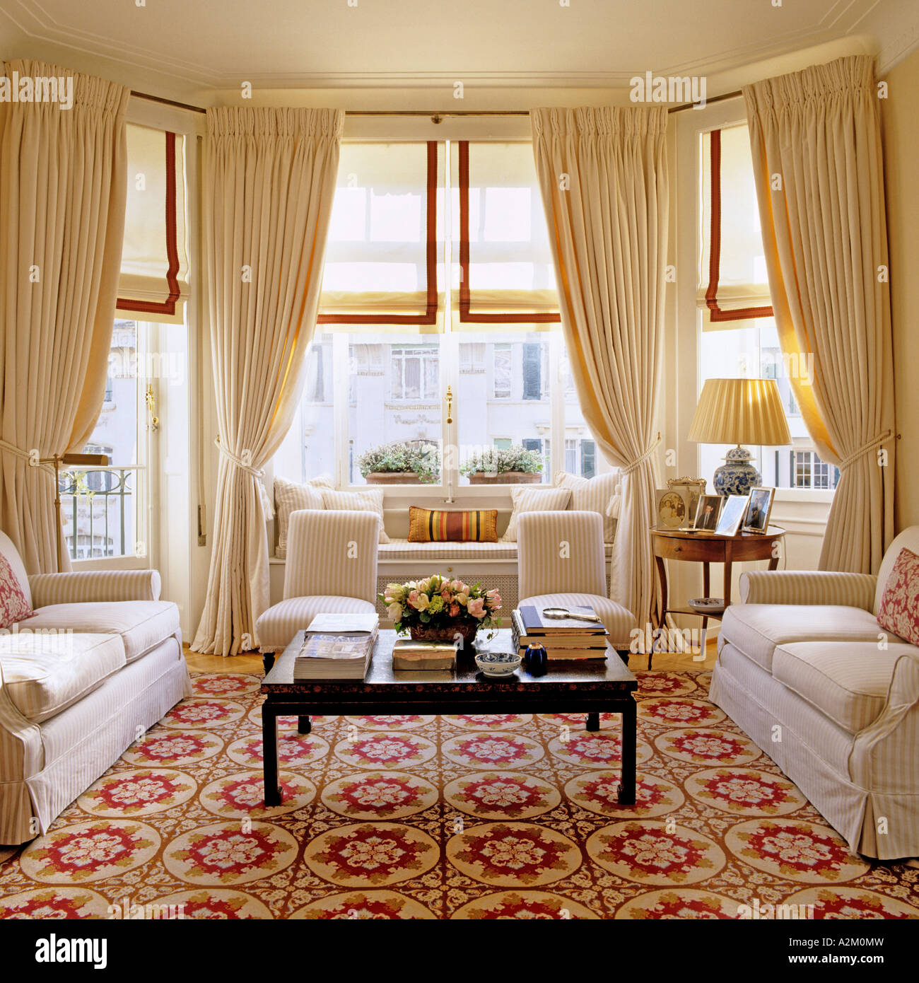 living room with carpet furniture layout for large rectangular three sofas patterned and bay windows