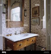 Marble-topped washstand in bathroom of English country ...