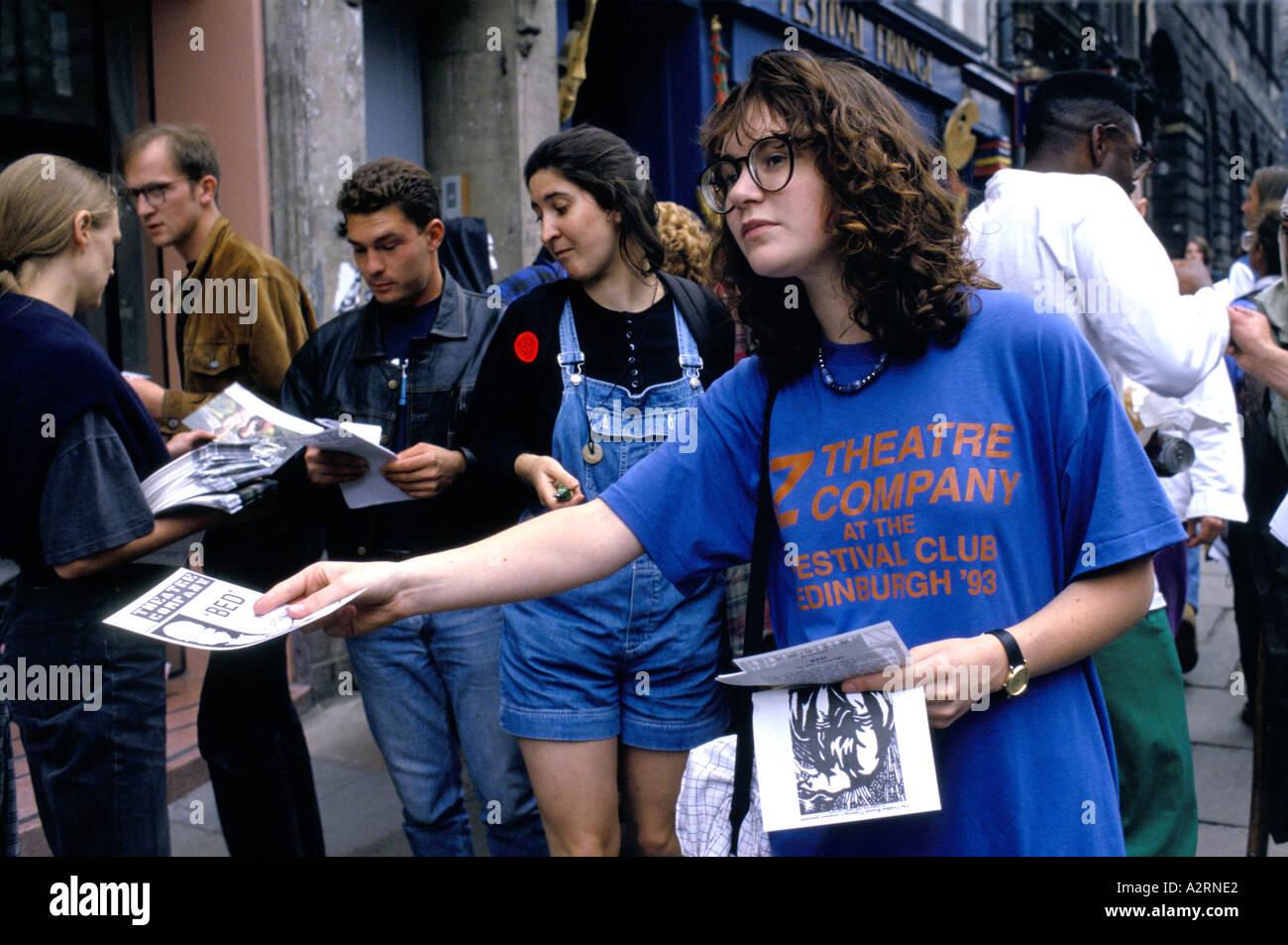 theatre company staff handing out flyers on the street edinburgh Stock Photo: 3455457 - Alamy
