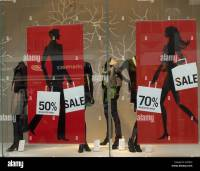 Sale posters in shop windows on british High Street Stock ...