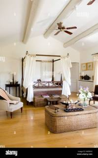 Bedroom with wicker storage chest, four poster bed and ...