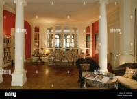 White pillars in open-plan white and red French apartment ...