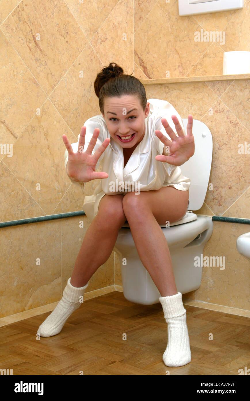 Woman Sitting On Toilet Stock Photos  Woman Sitting On