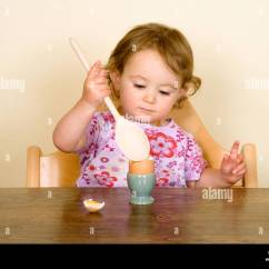 Baby Eating Chair Cheap Game Chairs Boiled Egg In High Stock Photo Royalty