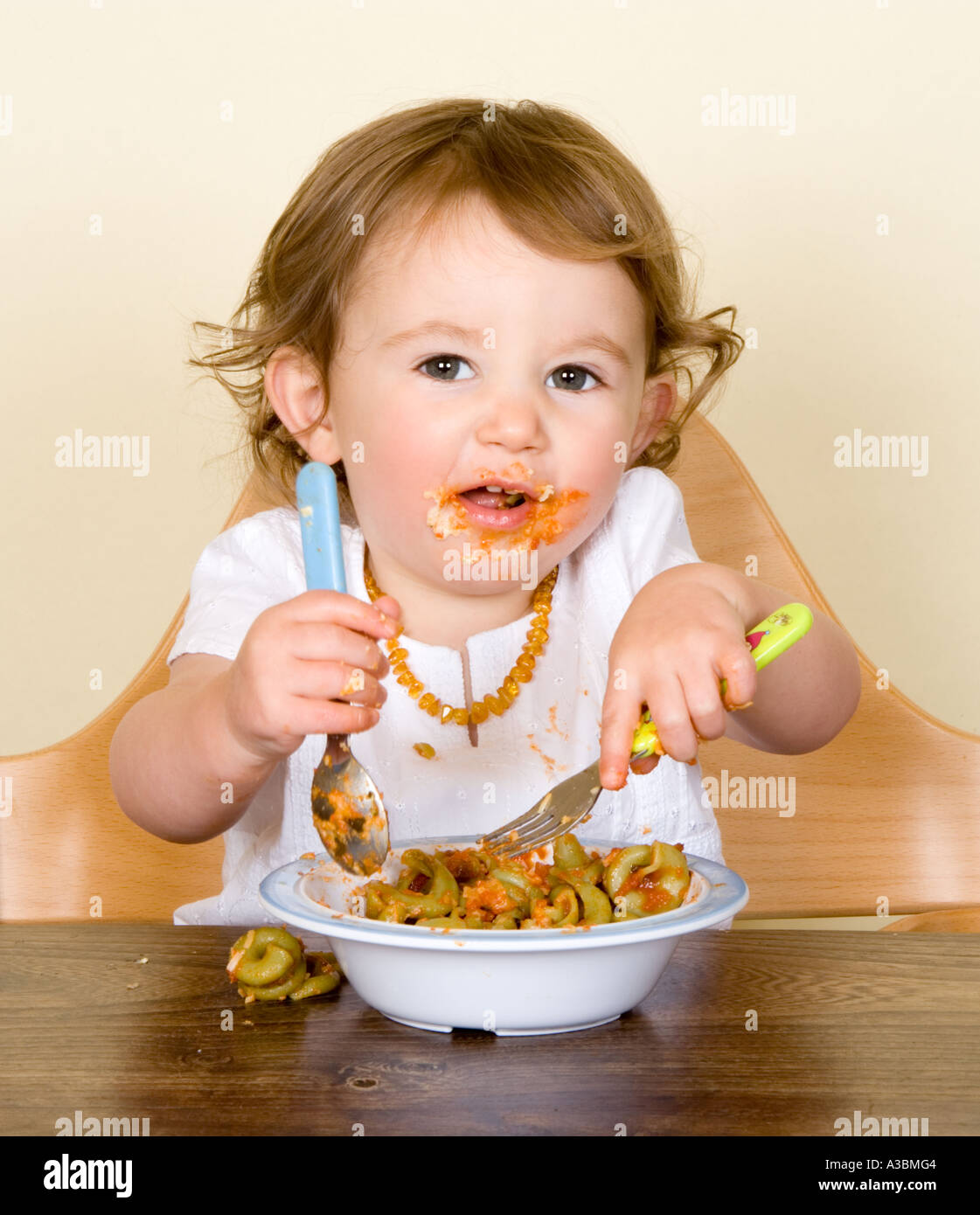 baby eating chair ladder back dining pasta in high stock photo 6134275 alamy