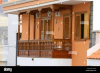 traditional wooden balcony on an apartment with orange ...