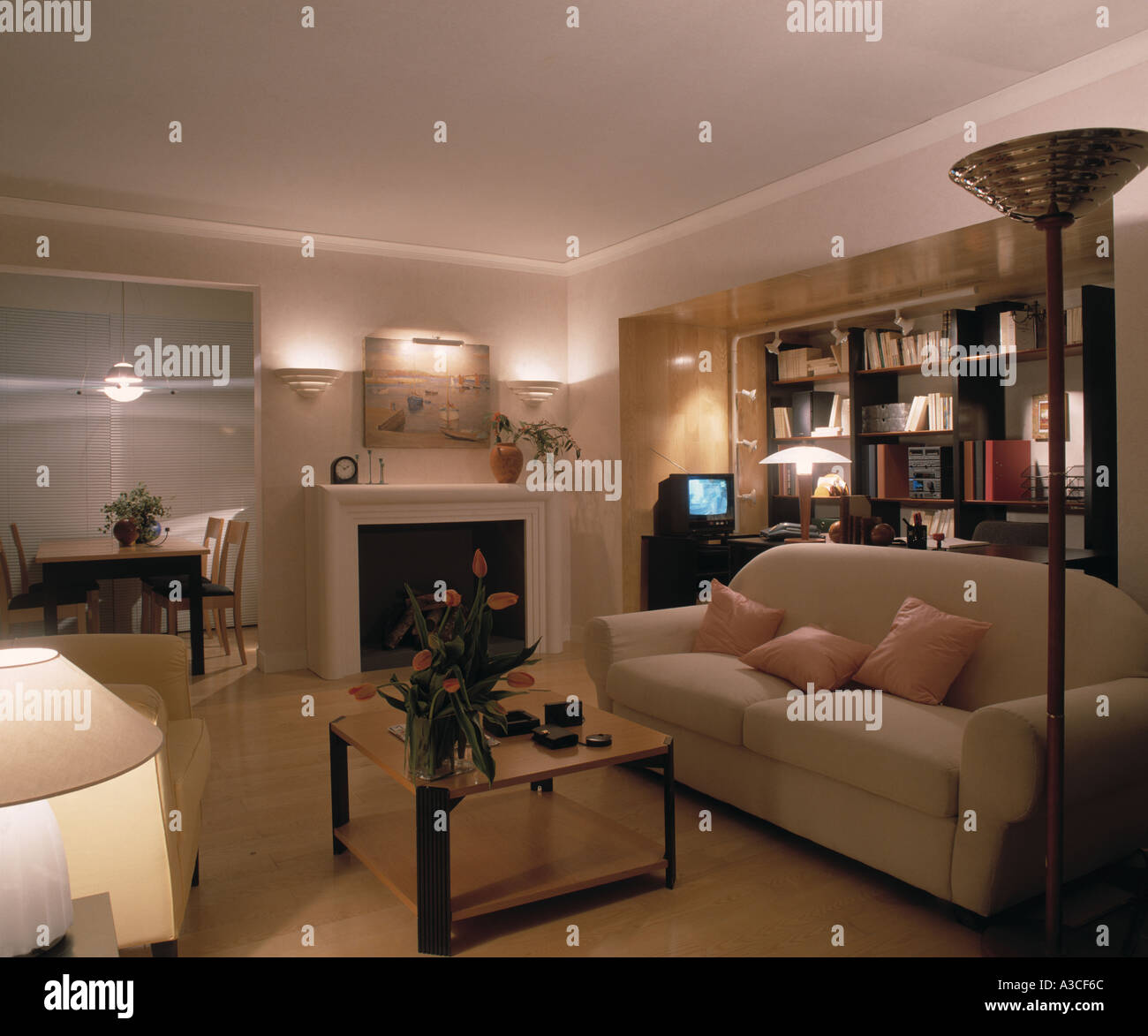 wall lamps living room open concept kitchen designs cream sofa and lighted lights in modern with small television beside bookcase