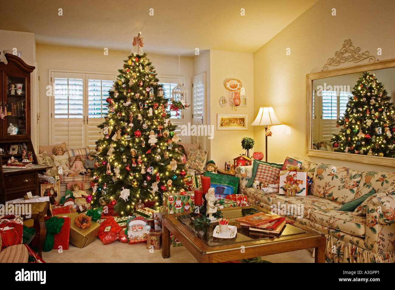 Christmas tree decorations and gifts in living room of