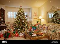 Christmas tree decorations and gifts in living room of ...