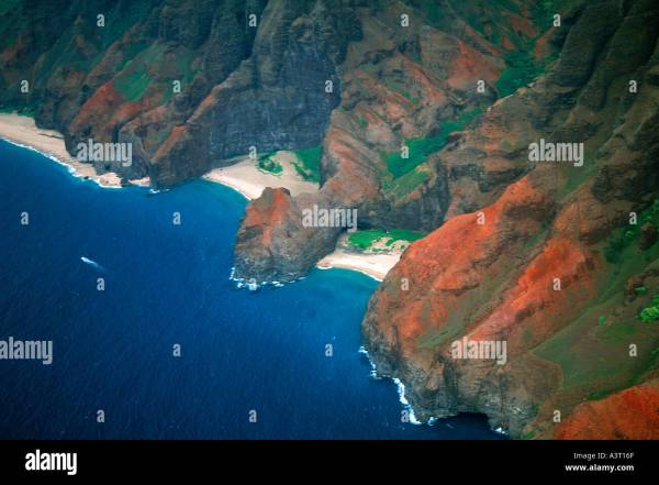 Cliffs and hidden beaches aerial view of Napali coast