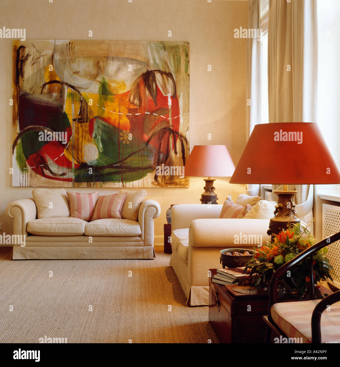 sofa paintings abstract square sectional large painting above cream in upmarket