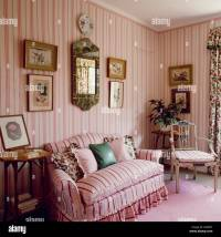 Pink striped sofa in country living room with pink striped