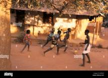 Children Playing Soccer in Africa