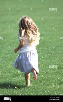 Little Girl Running Barefoot Grass Stock