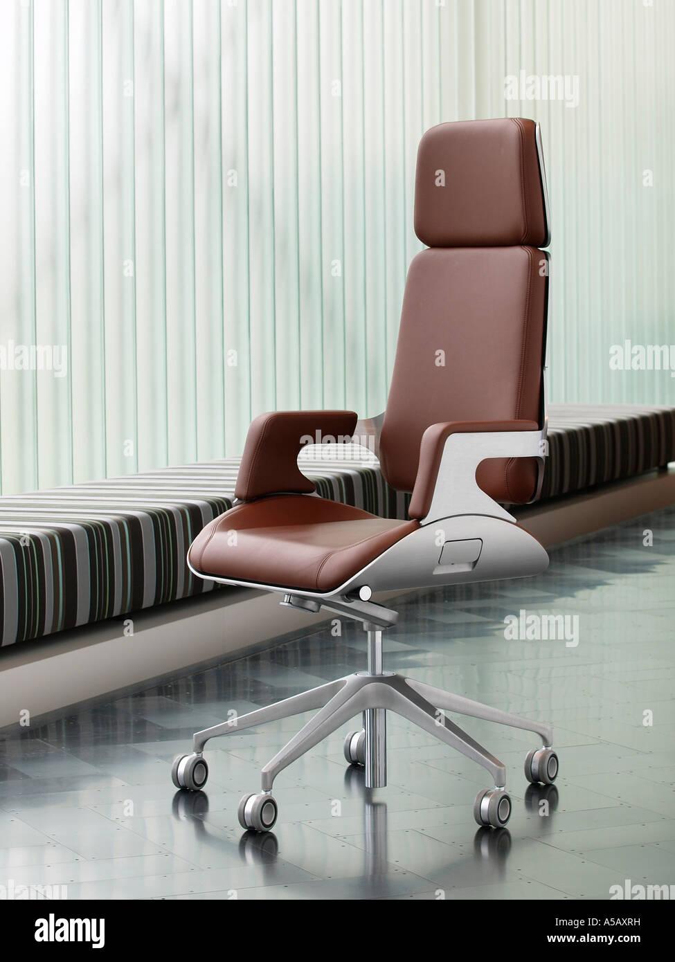 steel chair for office vanity stool brushed metal and brown leather luxury on dark parquet floor design furniture interstuhl silver 362s