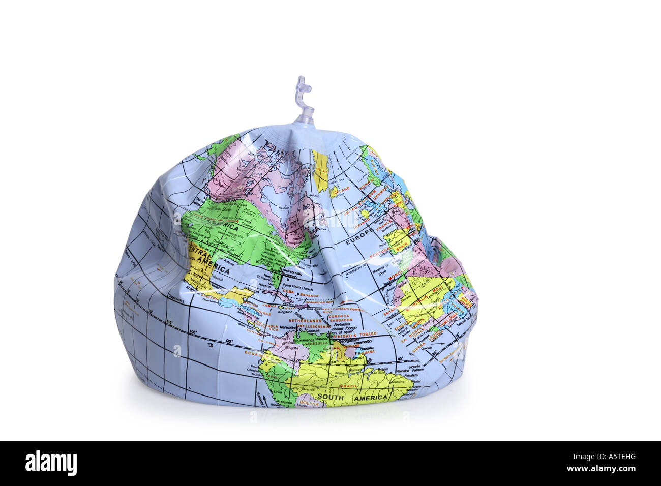 Deflated Earth Globe Cut Out On White Background Stock