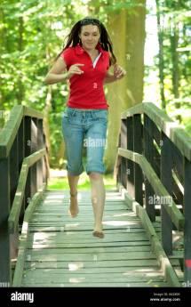 Young Girl Running Barefoot Wooden Bridge In