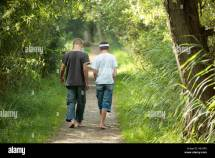 Two Boys Walking Forest Path In Bare Feet