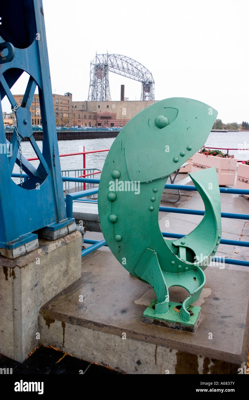 hight resolution of green fish sculpture overlooking lakewalk canal and aerial lift bridge duluth minnesota usa