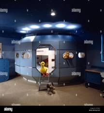 Eighties Children' Bedroom With Space Capsule Bed And Toy