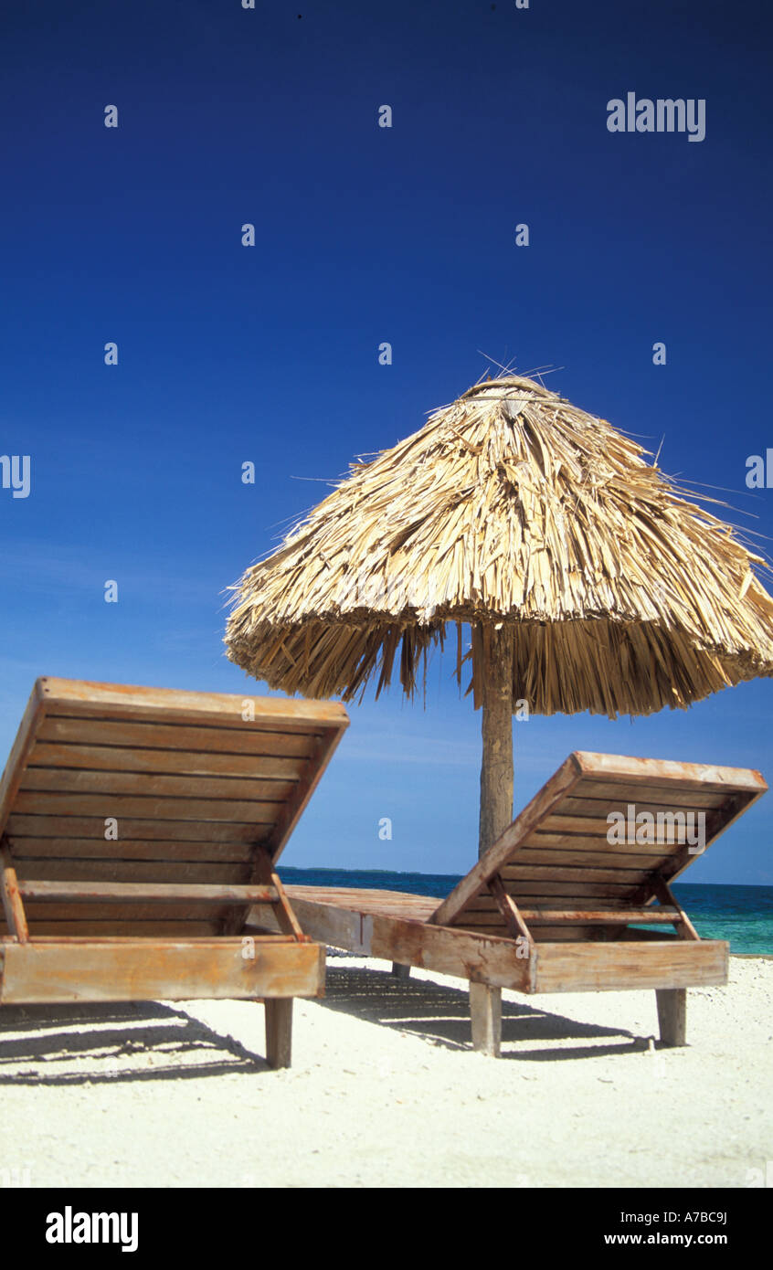 beach chairs with shade cheap chair covers walmart wooden and thatch sun on sandy stock photo