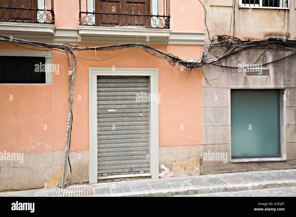 medium resolution of dangerous exposed electrical wiring on outside of house granada spain