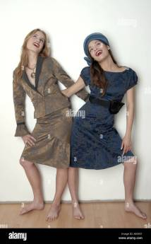 Barefoot Women in Dresses Posing
