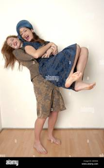 Barefoot Women in Dresses Posing