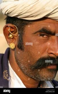 Gujarati Tribal man wearing typical mix of gold earrings ...