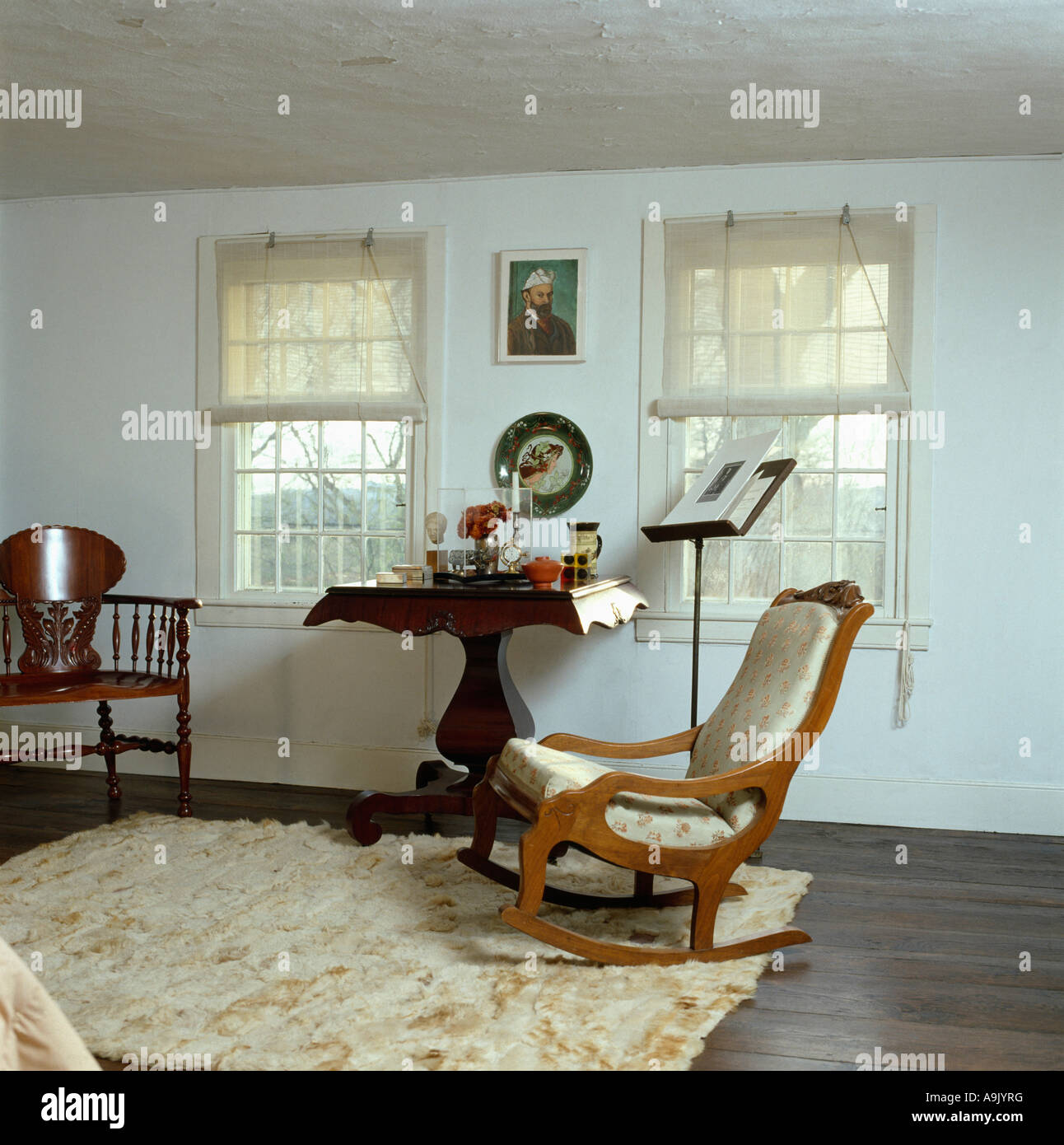 bedroom rocking chair drafting office cream ponyskin rug on dark wood floor in white with and small antique table
