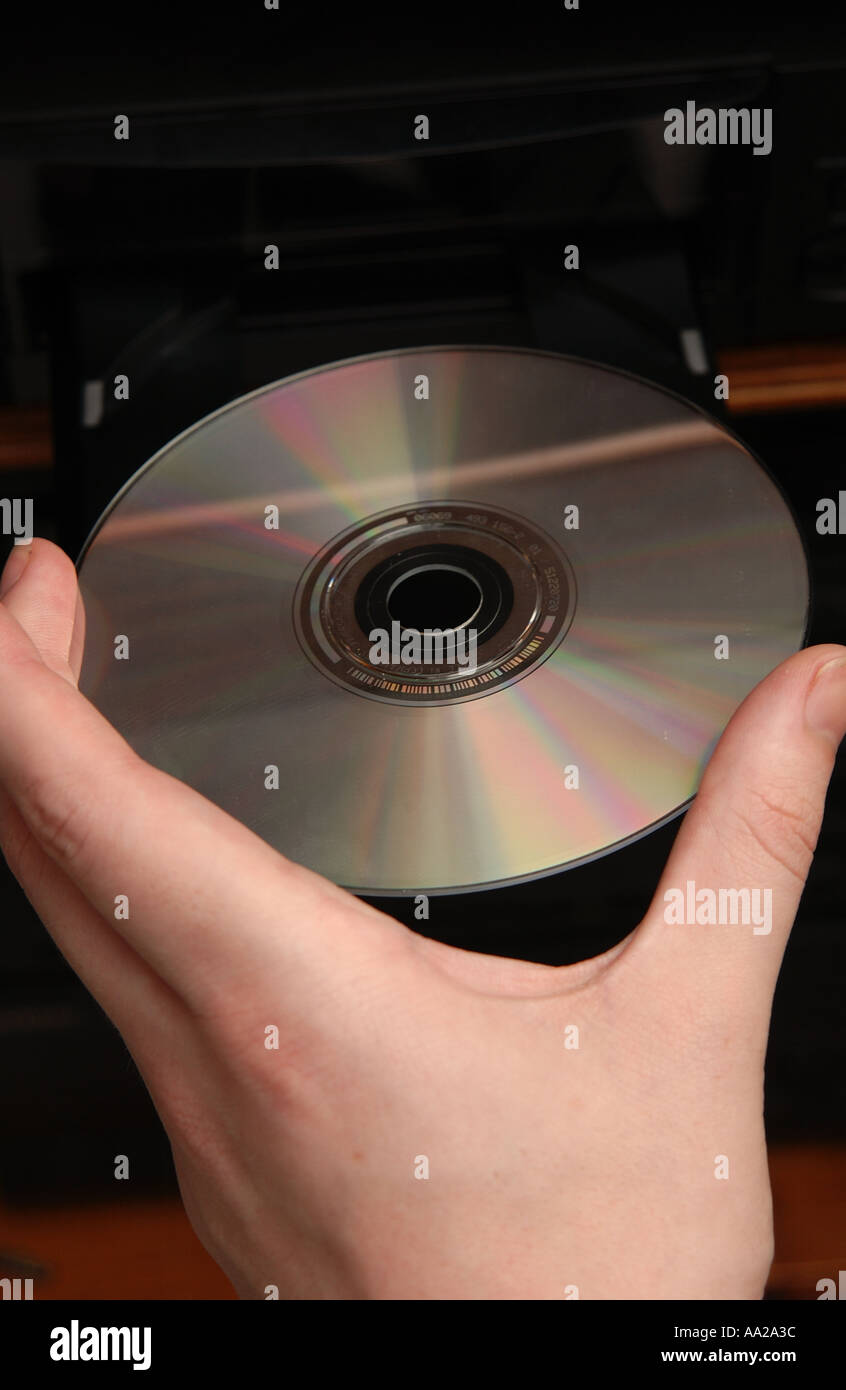 person putting cd into